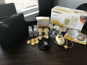 Medela freestyle breastpump - NEW CONDITION! 100% Recommend!