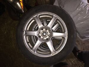 16x7 4 bolt universal with all seasons.