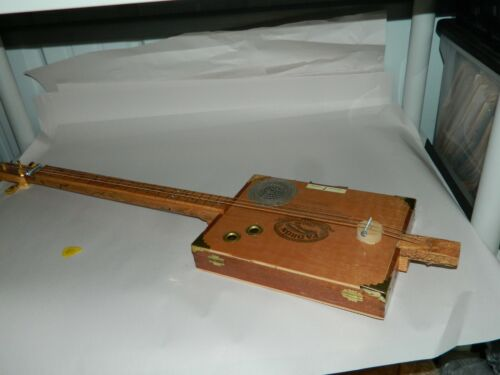 Super nice and clean basically unused cigar box guitar. Looks Great 3 strings