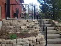 Curved wrought iron railings.