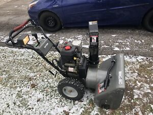 Self propelled snowblower with assisted start and light