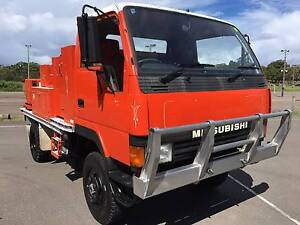 Mitsubishi Canter 4x4 Traytop/Fire Truck.Rural Fire Service. Inverell Inverell Area Preview