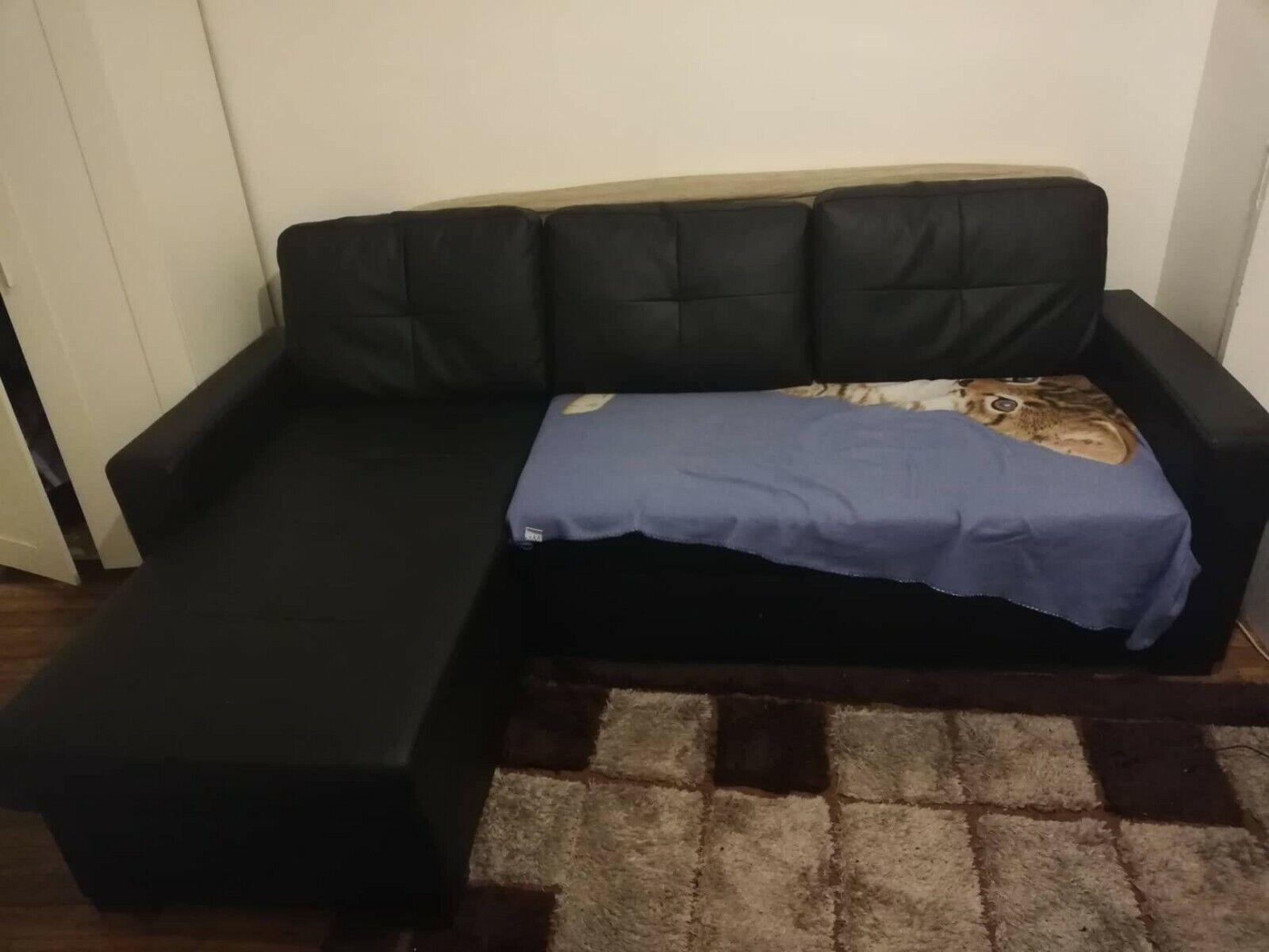 Canapé d'angle convertible ( 3 places ) avec rangement en similicuir noir