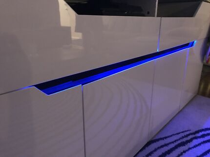 White TV Unit with Blue Light