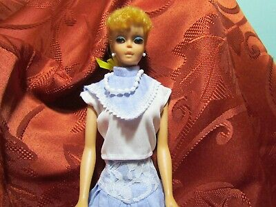 Vintage 1960s blonde ponytail barbie doll w/solid body