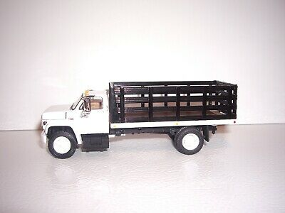 DCP FIRST GEAR 1/64 WHITE CAB BLACK STAKE SIDE GMC 6500 SINGLE AXLE STAKE TRUCK  1