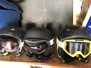 Snow boarding helmets with goggles . 2