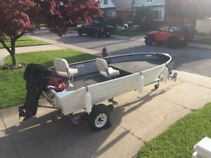 14' aluminum fishing boat & motor & new trailer