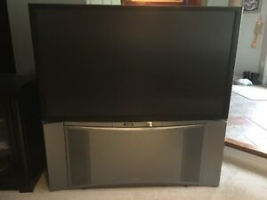 "60"" Tube TV with stand attached"