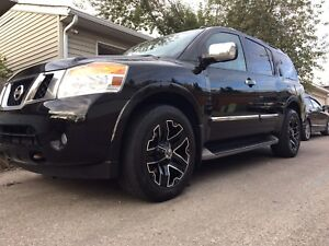 2012 Nissan Armada platinum after market rims tow package