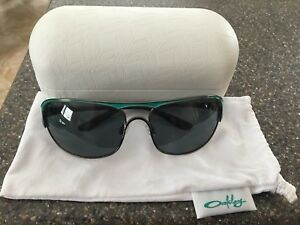 Woman's polarized Oakley sunglasses.