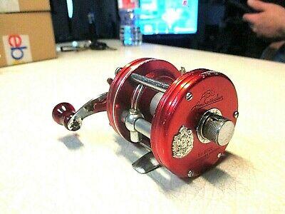ABU GARCIA AMBASSADEUR FISHING REEL - RED 5000 - REEL WORKS GOOD..