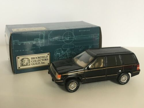 Brookfield Collectors Guild Jeep Grand Cherokee Coin Bank with Key Black Car