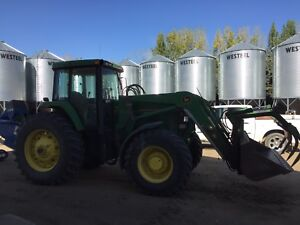 John Deere 7600 MFWd with 740 ldr and grapple