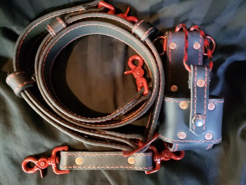 Custom leather firefighter radio strap, sway, and bucket with red hardware.