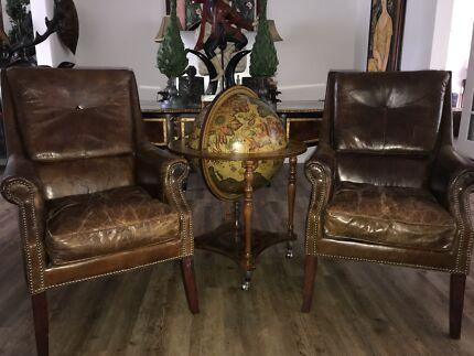 Brown Leather vintage look arm chairs .