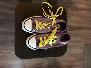 Purple and gold converse