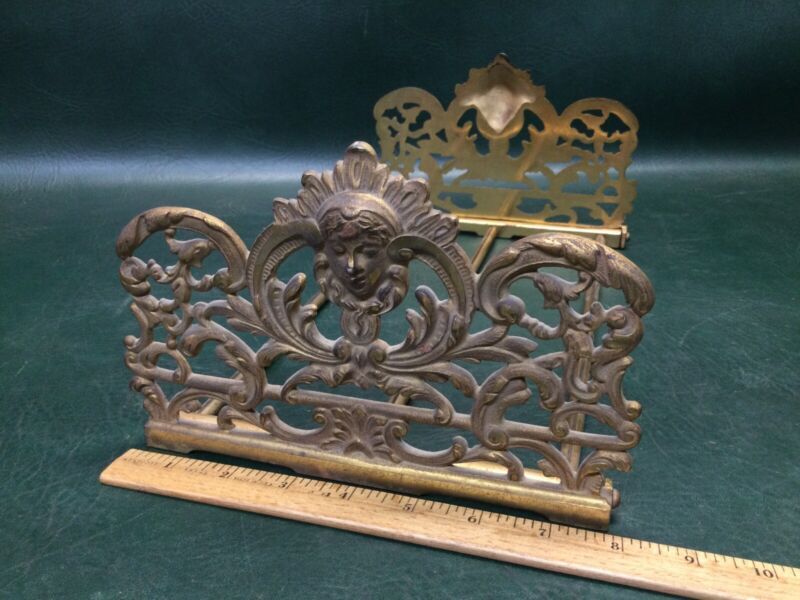 Vintage Cast Iron Expandable Foldable Bookends Stand Rack Ornate w/ Faces