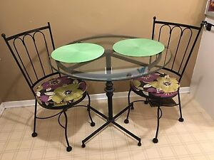 Glass top, rod iron table with 2 chairs