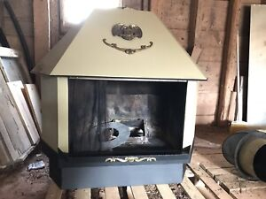 Vintage wood stove with hardware & tag. Can be insured.
