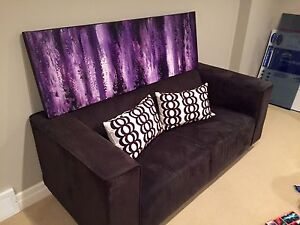 Grey Couch, Purple Painting & Down Pillows