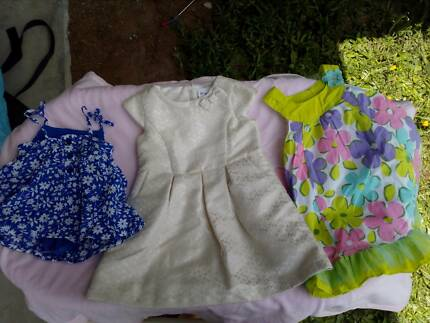 4 big bags of baby girl dresses sizes3-6months up to 12months $10