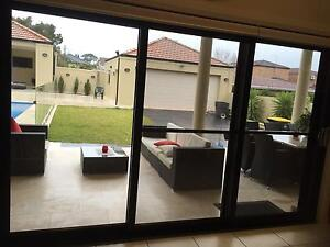 Black Stacker Doors with flyscreens ( commercial grade) Enfield Burwood Area Preview