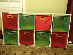 Green and orange plastic bins with wooden frame