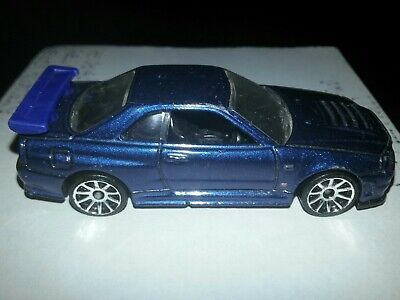 Hot wheels 1/64th scale blue nissan skyline gt-r r34 LOOSE IN GOOD CONDITION