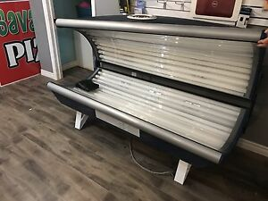 Tanning bed for a home