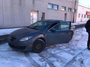 Mazda 6 2009 avec pneus d'hiver et d'été sur mags