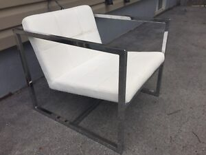 White chair with metal arms