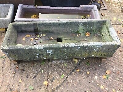 Antique stone trough with central drain