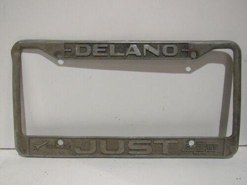 RARE Vintage Delano Just Chevrolet Olds metal License Plate Frame Embossed CA