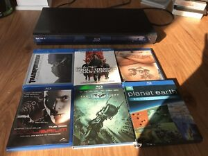 Sony Blu-Ray Player and 6 Blu-Ray Discs.