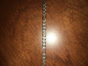 Real silver Figaro chain