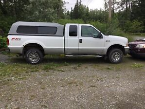 Ford 2003 (late) F250 SuperDuty + Canopy & Winter Tires on Rims