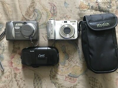 Camera Lot Canon And Two Kodak Cameras (L)