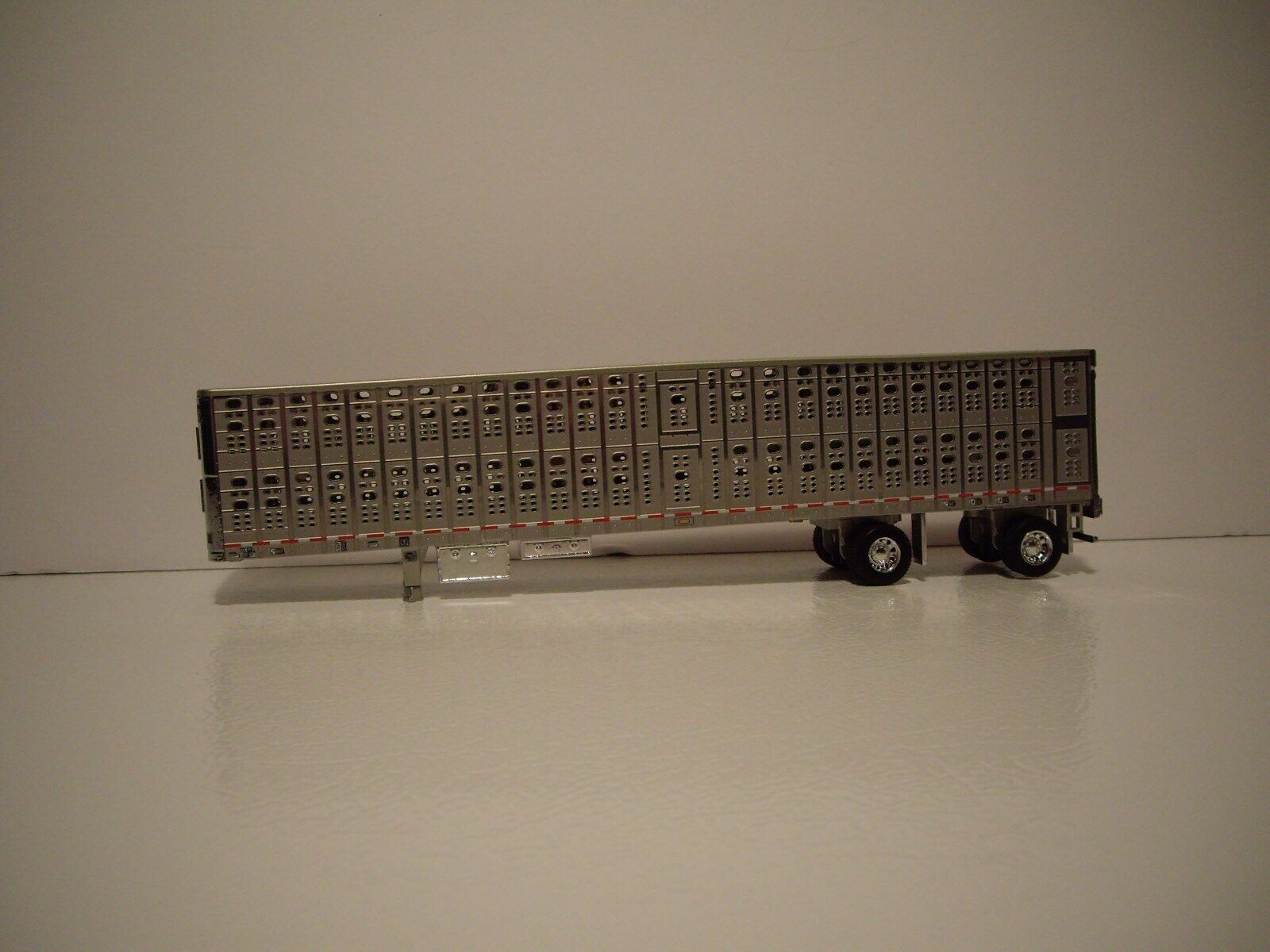 DCP FIRST GEAR 1/64 NEWLY TOOLED WILSON SILVER AND CHROME SPREAD AXLE LIVESTOCK  1