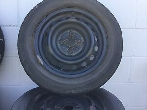2 sets of Steel rims with lower tread tires