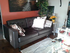 Ikea dark brown tuffted leather couch