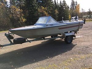 Boat motor and roll off trailer