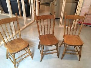 Three antique press back chairs