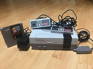 Original Nintendo with two controllers and a game