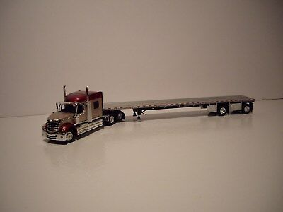 DCP FIRST GEAR 1/64 TAN&RED INTERNATIONAL LONESTAR WITH SLEEPER AND FLAT BED