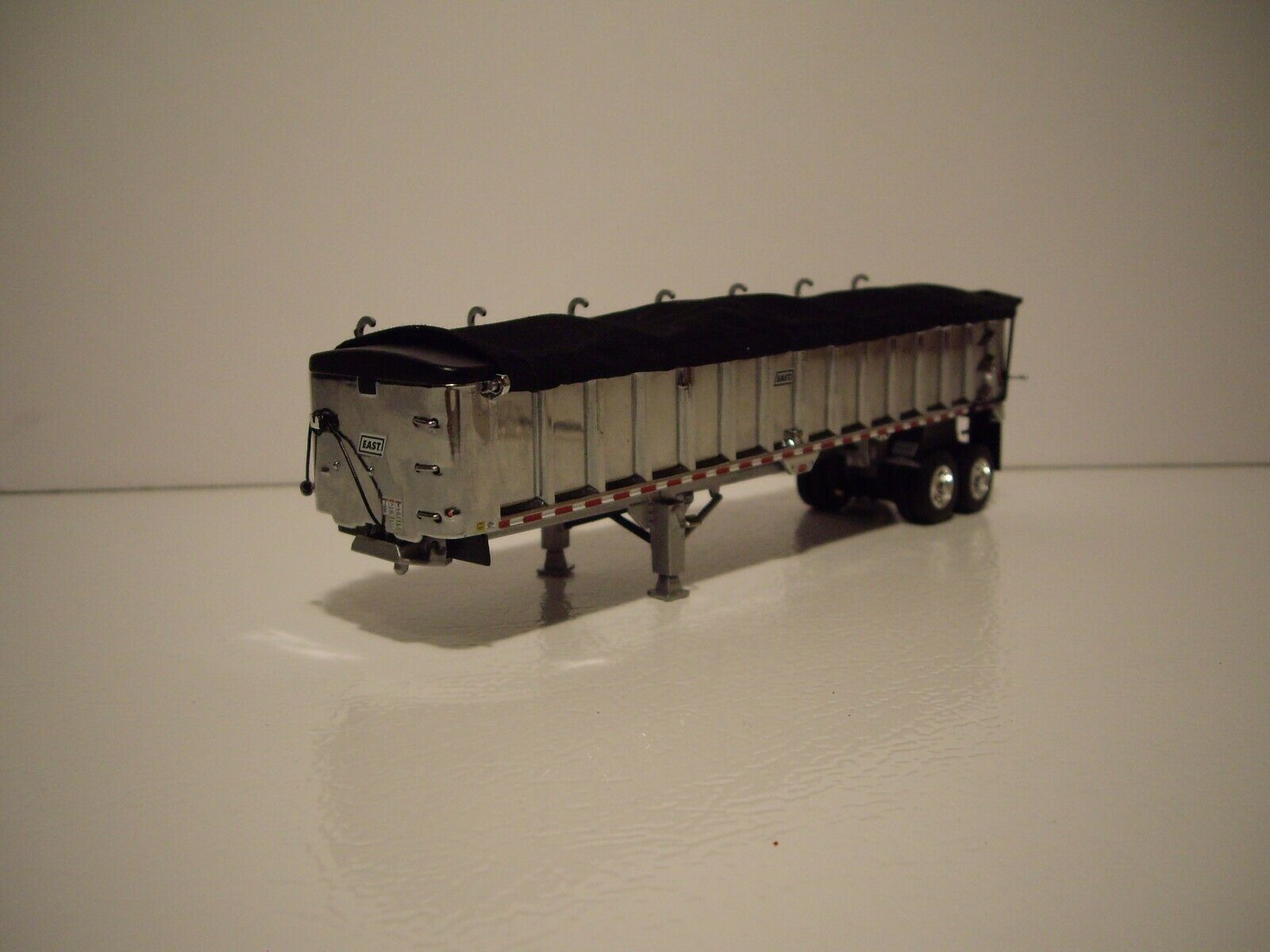 DCP FIRST GEAR 1/64 CHROME WITH BLACK TARP TANDEM AXLE EAST END DUMP