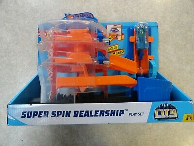 BRAND NEW Hot Wheels Super Spin Dealership Play Set with Car Launcher Toy