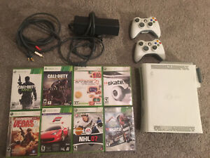 Xbox 360 w/ two controllers and 8 games