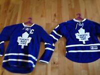 2 official Toronto maple leafs jerseys.