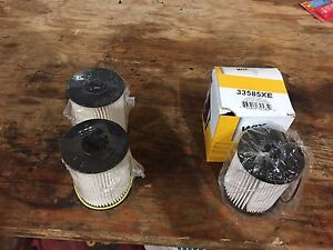4 new fuel filters dodge 5.9 cummins